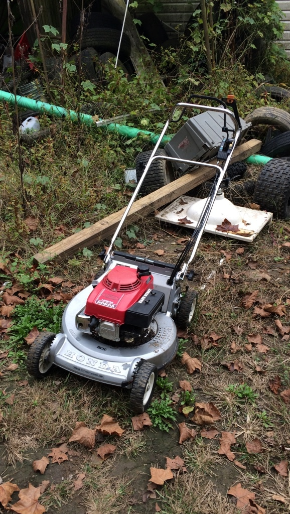 Grey, Red, And Black Honda Push Lawn Mower