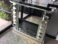 Mirror fireplace with adjustable temperature and timer. Brand new.