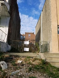 VACANT LOT WITH DRIVEWAY