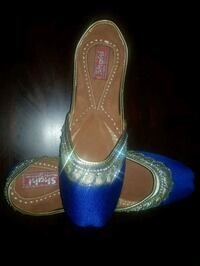 pair of blue-and-brown leather flats