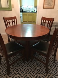 Round brown wooden table and four chairs Durham, 27705