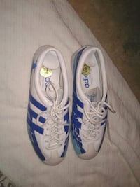 pair of white-and-blue Adidas cleats Winnipeg, R2W 2G8