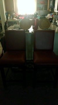 two black leather padded chairs Scottdale, 30079
