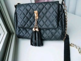 Black crossover pleather bag