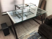 Rectangular glass top table with elevated glass level and brown legs   Boulder, 80301