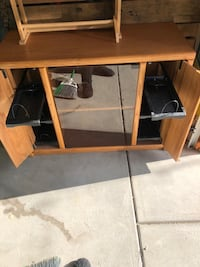 Tv stand with pull out drawers for cd/dvd.