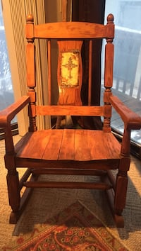 Brown wooden rocking chair with brown cushion!