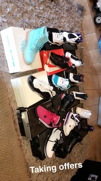 Assorted colors and brands of shoe lot