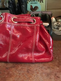 red leather tote bag with wristlet