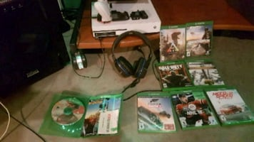 Xbox1s with 8 games,
