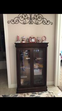brown wooden framed glass display cabinet New Harmony, 84757