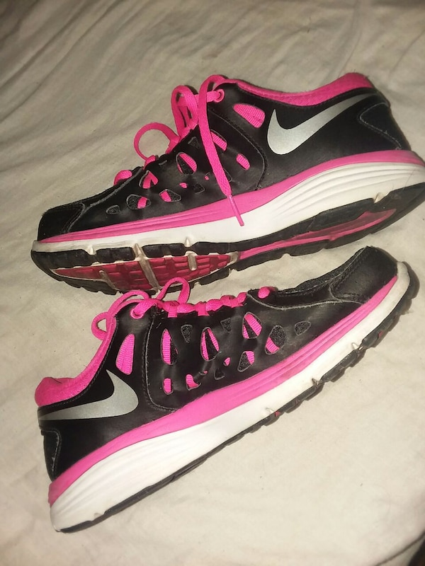 black-and-pink running shoes