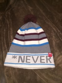 gray and white bubble knit cap