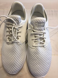 pair of white Nike running shoes Gaithersburg, 20879