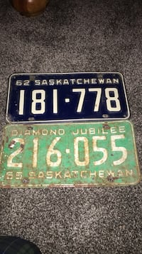 Two green and blue license plates 2674 km