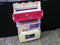 purple, pink, and gray wooden shelf