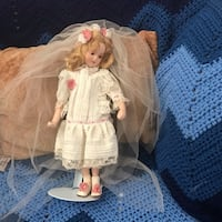 girl doll wearing white dress Rockville, 20853