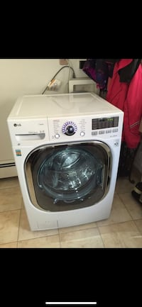 White lg front-load clothes washer New Hyde Park