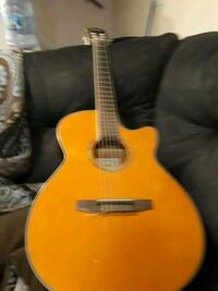 yellow and black dreadnought acoustic guitar North Attleborough, 02763