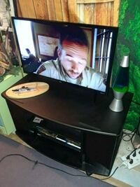 New flat screen TV, dvd/blue ray, and stand