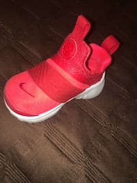 pair of red Nike running shoes Victorville, 92394