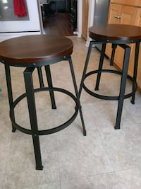 two brown wooden bar stools Franconia
