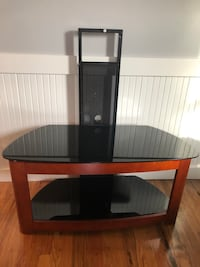 brown wooden table with black metal base 411 mi
