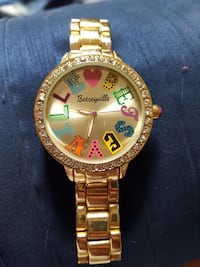 round gold Betseyville analog watch with link bracelet