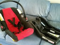 baby's black and red car seat carrier