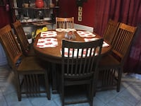 Oval brown wooden dining table with chairs set New Market, 35761