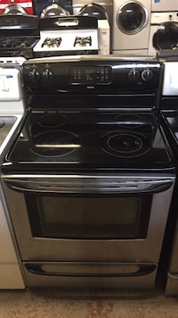 Kenmore stainless steel electric stove 4 months months warranty  Baltimore, 21230