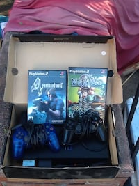 Black Sony PlayStation 2 set comes with 2 games residents evil 4 and Maximo 2 controllers 2 memory cards 2 hook up wires for just $211 dollars and pick up only Los Angeles, 91325