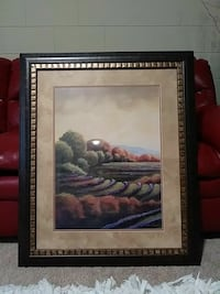 forest painting with black wooden frame