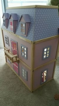 Wooden doll house like new.