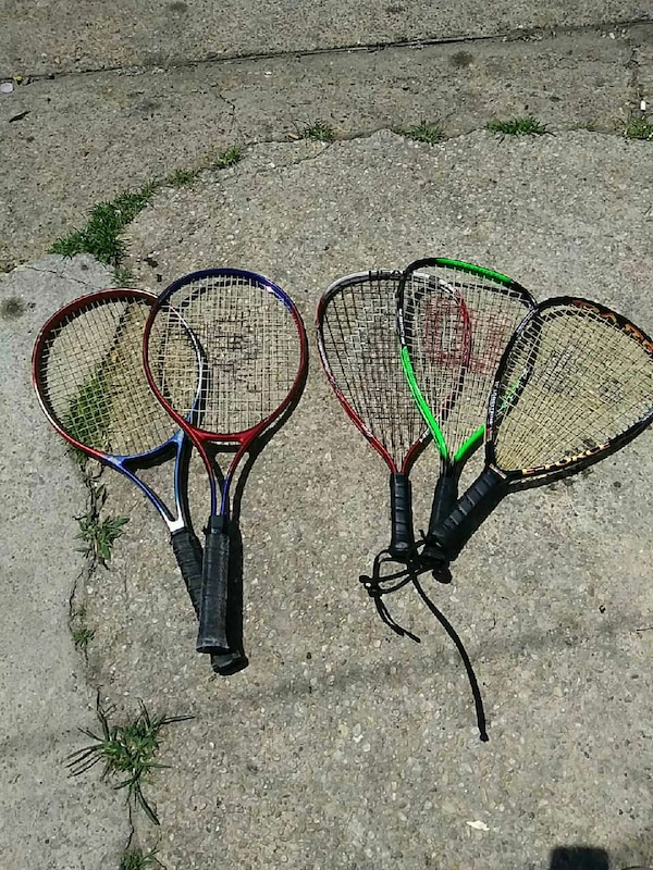 five tennis rackets