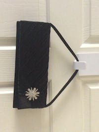 Black fancy clutch handbag with Dimond flower. North Vancouver, V7G 2S5