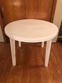 White resin patio table with removable legs
