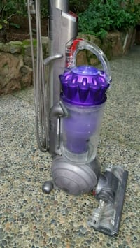 purple and gray Dyson upright vacuum cleaner 2413 mi