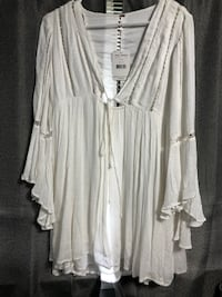 White long-sleeved dress. Free people brand, never worn before with tags. Paid $128  Bradley, 60915