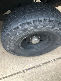 black vehicle wheel with tire Youngstown, 44512