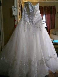 Wedding dress with front and back Vail, never worn or used.