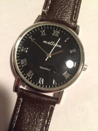 Round black analog watch with brown leather strap Allentown