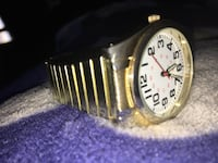 Gold and white analog watch with link strap bracelet Winnipeg, R2C 3P4