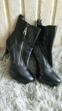 pair of black leather platform stiletto booties Silver Spring, 20901