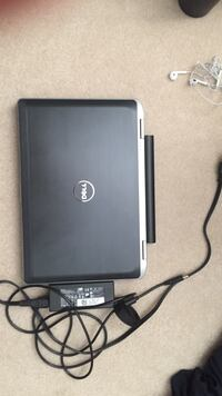 Black and gray dell laptop with black ac adapter Ashburn, 20147