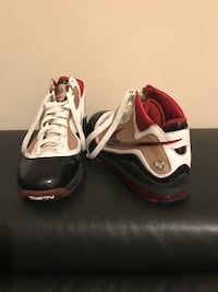 pair of gray-and-red Nike basketball shoes 300 mi