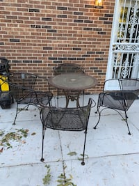 Set of four heavy duty real wrought iron chairs