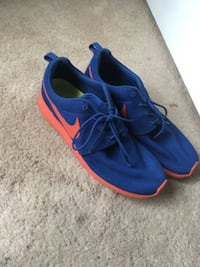 pair of blue-and-red Nike running shoes 56 km