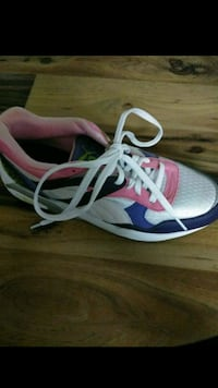 white-and-pink Nike running shoes Washington