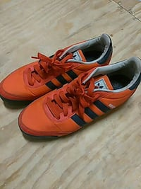 pair of orange-and-black Adidas low-top sneakers Tallahassee, 32310